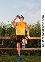 running man drinking