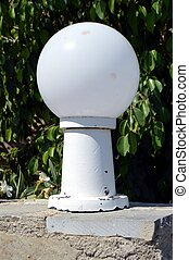 Lamp on foot with white ball.
