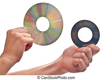Cd\'s in hand - Two cd\'s in woman\'s hand. Isolated on...