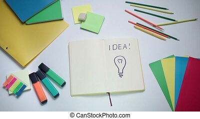 Word Idea and light bulb written on white note pad - Word...