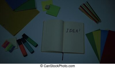 Brightening up word Idea written on note pad - Top view of...