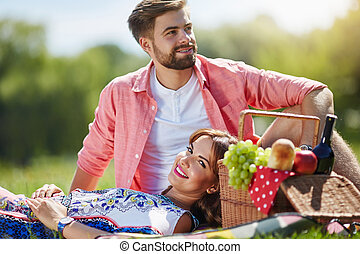 Sweet laziness - A photo of young, happy couple relaxing on...