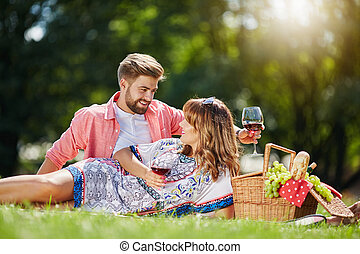 Talking over a glass of wine - A photo of young, happy...