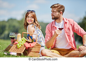 Shes looking at him with love - A photo of young, happy...