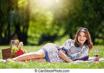 Pretty woman relaxing at the park - A photo of young,...
