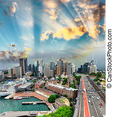 Sydney skyline at sunset. Aerial view from Harbour Bridge...