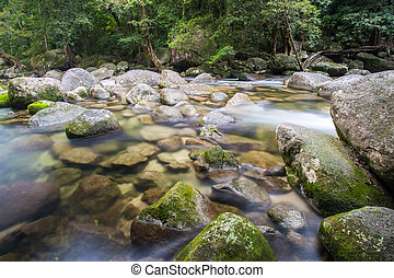 Mossman Gorge Rapids - Water of the Mossman River flows over...
