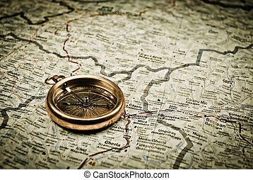 Vintage compass - Vintage gold compass points on an old map
