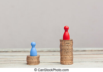 wealth concept, red and blue pawn on coin stacks - two coin...