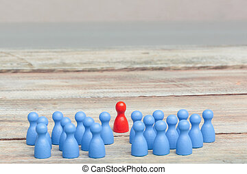 crowd of blue pawns, with red pawn - a crowd of blue pawns,...
