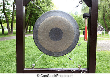 Gong in a park. Device for alarm