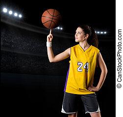 Young girl basketball player at gym