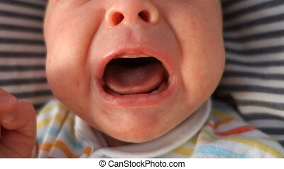 Mouth of crying newborn baby, audio, close-up, top view