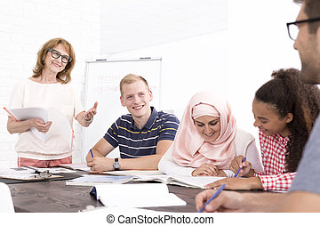 Studying in multicultural atmosphere - Group of young people...