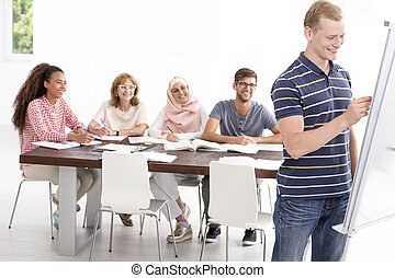 Language course in positive atmosphere - Young man writing...