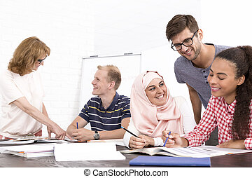 Cultural differences in the workplace - Group of happy young...