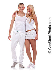 Sexy young couple wearing white clothes in the studio