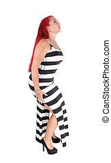 Woman in long black white dress.