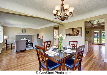 Open floor plan. View from dining area with wooden table...