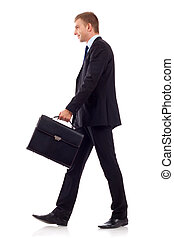 walking man holding brief - going business man holding brief...