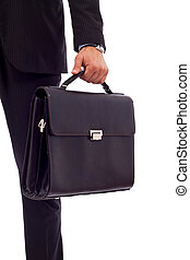 business man holding a suitcase - Low section image of a...