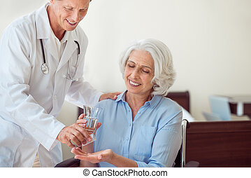 Senior woman taking pills - Health care Cropped image of...