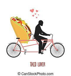 Lover taco. Mexican food on bicycle. Lovers of cycling. Man rolls fast food on tandem. Joint walk with meal. Romantic date undershotLover taco. Mexican food on bicycle. Lovers of cycling. Man rolls fast food on tandem. Joint walk with meal. Romantic date undershot