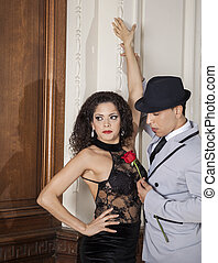 Tango Dancer Holding Rose While Standing With Female Partner...