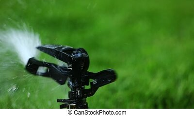 Garden sprinkler. Selective focus. - Close-up on a sprinkler...