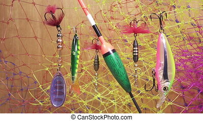 float and baits on a fishing net background ,