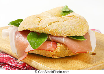 Bread roll (friselle) with slices of Schwarzwald ham -...