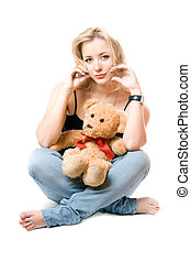 Pretty young blonde with a teddy bear