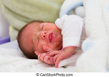 Newborn Crying - Cute little crying baby in bed asking for...