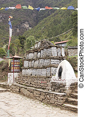 Buddhist Mani Stones - Buddhist Mani stones and prayer wheel...