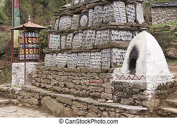 Buddhist Mani Stones - Buddhist Mani stones and prayer wheel...