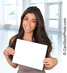 Young woman and sign - Beautiful young woman holding a blank...