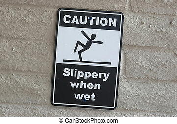 Caution slippery when wet sign on wall
