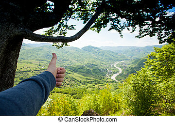 Wonderful scenery of green moutain - The man is showing that...