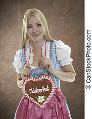 Smiling woman with Oktoberfest heart - Smiling woman with...