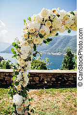 wedding arch with flower decoration close up with beautiful...