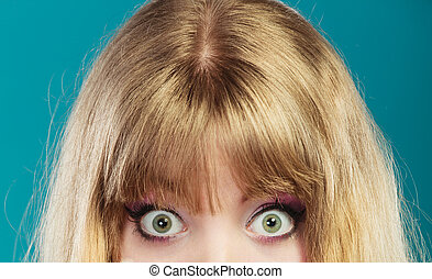 Big eyes blonde woman. - Pretty woman on blue. Young big...