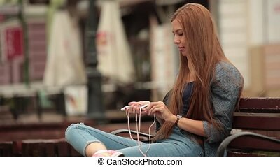 Young woman with phone.