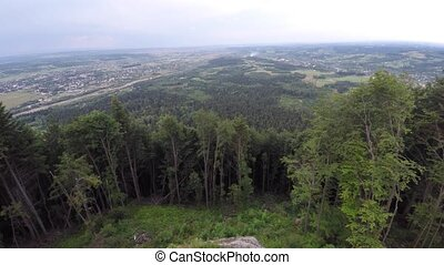 The mountain ridge covered with forest. Mountain landscape. Drone video.
