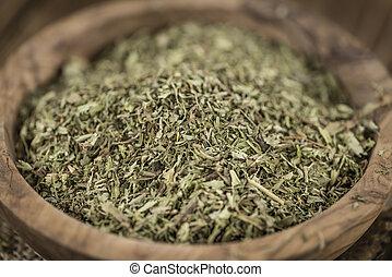 Heap of dried Stevia leaves (sweetener) on vintage...