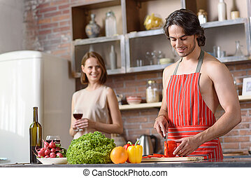 Happy married couple cooking romantic dinner - Handsome...