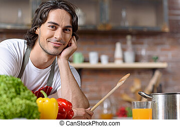 Male chef waiting for healthy food - Relaxed young man is in...