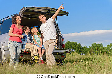 Smiling happy family and their car - Getaway with kids. Shot...