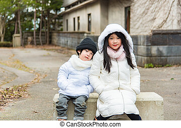 Asian child in winter - Close up of asian child wearing...