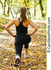 Warm up before running - Photo of young woman warming up...