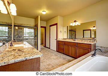 Luxury bathroom interior with granite trim and two vanity...